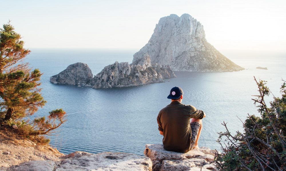 Solo traveller on rock  dull travel   Backpacking with Bacon